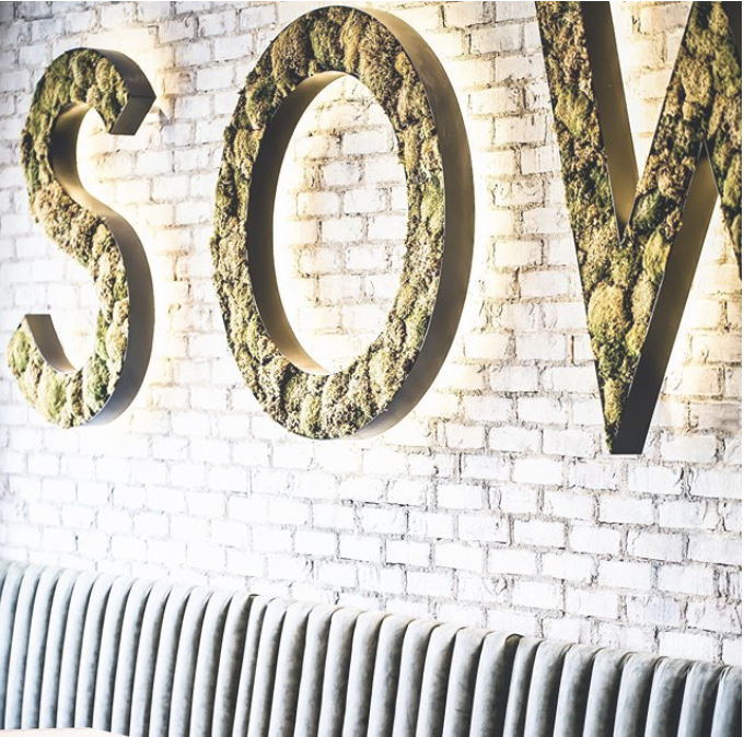 The SŌW Plated logo on the restaurant wall.