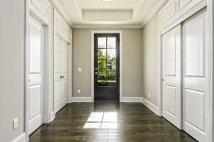 A front door with a style current in door trends.