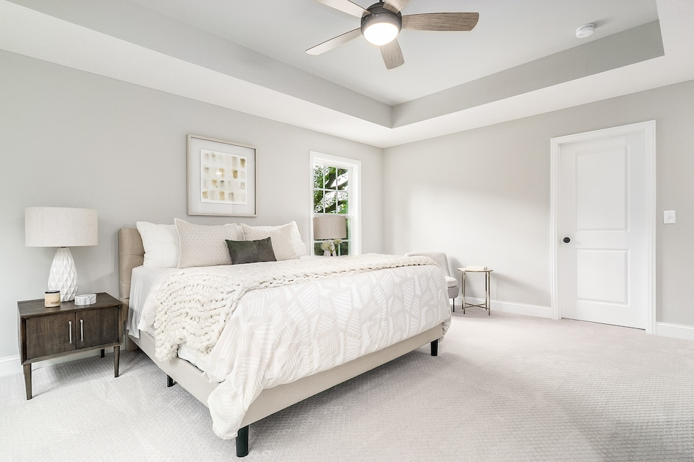 A master bedroom with a great color palette.