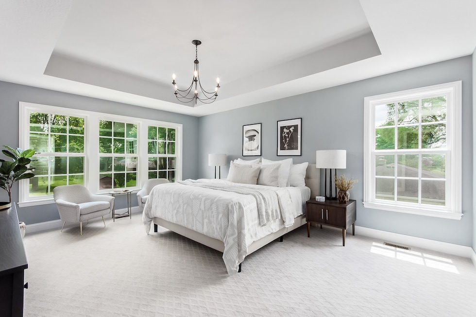 A master bedroom with plenty of natural light.